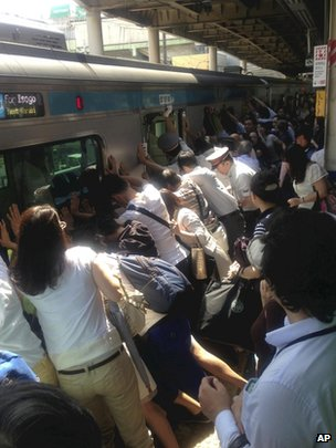 Japan commuters free woman trapped under train