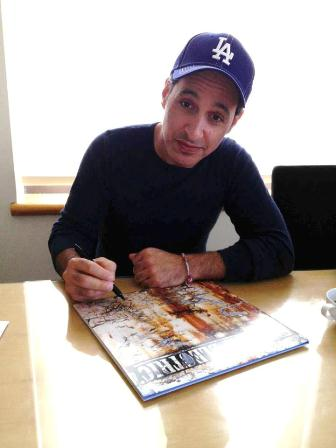 Nick, signing the album