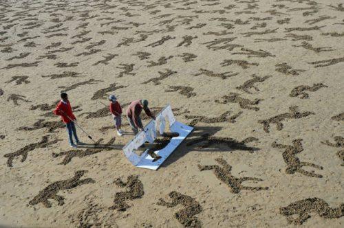 normandy-body-sand-stencils-beach-11.jpg