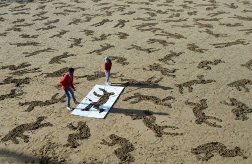 normandy-body-sand-stencils-beach-14.jpg