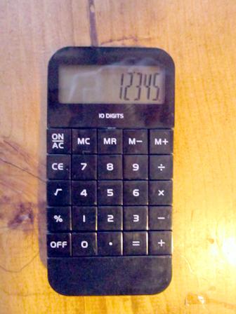 アルミケースと電卓2